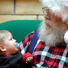 Ten-month-old William Harding of Blue Earth wasn't quite sure what he had gotten himself into during his first-ever encounter with Santa during a visit to the River Hills Mall earlier this week. Photo by John Cross