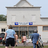 People walk to the Godahl Store after the Labor Day Parade on Sept. 3, 2012. The Godahl Store first opened in 1894 and is closing its doors on Saturday after 122 years of business. File photo