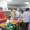 Customers shop at the Godahl Store on Sept. 3, 2012. The Godahl Store is closing its doors after 122 years of business. File photo