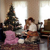From left, Leah Klammer, Halle Blais, Renata Olson and Isabells Stading string popcorn for a Christmas tree in Betsy's House during the Betsy-Tacy Society's Victorian Christmas Saturday.