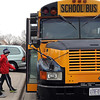 Students get on the bus to head back to school after the Peaseful School Bus retreat at the St. Peter Comunity Center.