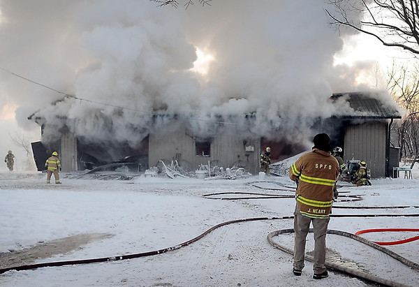 John Cross<br /> Firefighters were at the scene of large garage fire just north of Seven Mile Creek along Highway 169 North on  Wednesday. The garaage and contents were destroyed.