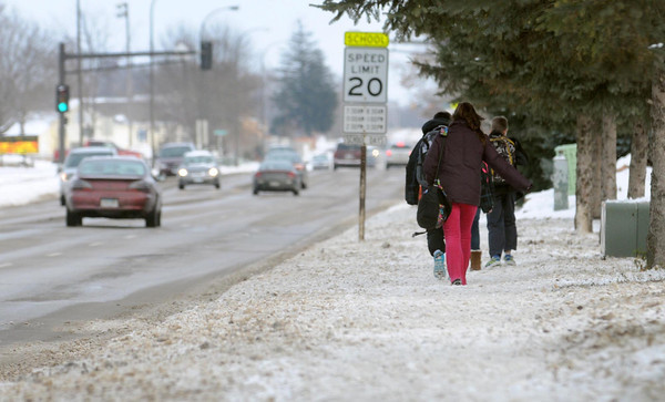 Pat Christman<br /> Students walk along Hoffman Road near Mankato East High Schools Friday. More than $425,000 in new Mankato sidewalks are planned for construction next year to provide safer routes to East and other  schools.