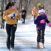 Pat Christman<br /> Gabby Nelson motivates Parker Beavens to keep running near the finish of the Reindeer Dash Saturday.