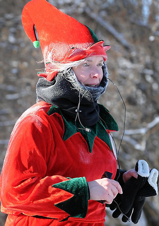 Pat Christman<br /> A runner is frosted over at the end of Saturday's Reindeer Dash.
