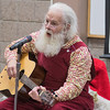 Kurt Martell dressed as Santa Claus sings Christmas songs at the Blue Earth County Library in Mankato on Saturday morning. Martell also shared some historical facts about the songs that he sang. Photo by Jackson Forderer