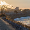 Elly Orcutt (left) jogs along the Minnesota River Trail as the sun set on Tuesday afternoon. Photo by Jackson Forderer
