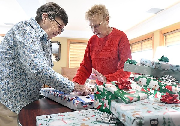 Seniors wrapping gifts 1