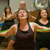 Deloris Smestad works out during a Pound Fitness class in St. Clair. The class has participants use drumsticks while working out to different upbeat songs. Photo by Jackson Forderer