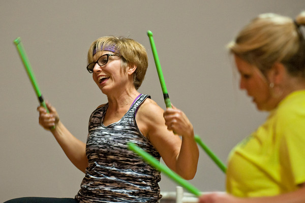 """Instructor Laurie Thorsted leads a Pound Fitness class in St. Clair on Dec. 1, 2016. Thorsted said she enjoys teaching the class and added, """"I like the social aspect of it, it's fun, I like the people that I work with."""" Photo by Jackson Forderer"""