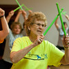 "Winnis Buesing, 75, taps her drumsticks together during a Pound Fitness class in St. Clair on Dec. 1, 2016. ""I cracked my left arm in 4 places a couple of years ago so the exercise has been excellent in rebuilding the strength in my left arm,"" said Buesing. Photo by Jackson Forderer"