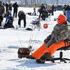 An angler gets comfortable as he waits for a fish to bite during the Big Bobber Ice Fishing Contest Saturday on Lake Washington.