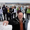 John Cross<br /> Gustavus Adolphus professor Jim Dontje points out some of the energy-saving devices installed on the roof of GAC's Olin Hall to area high school students participating in a Youth Energy Summit on Tuesday. Students visited several area facilities to view green features and alternative energy sources.