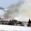 Firefighters from several departments fight a house fire at a home across from the Chankaska Creek Winery near Kasota Thursday.