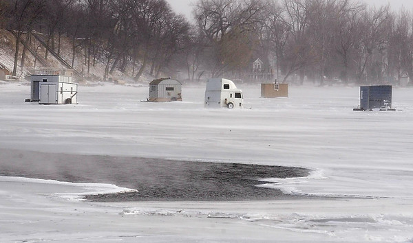 John Cross<br /> Steam rises from a patch of open water on the north edge of the narrows on Madison Lake.