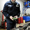 John Cross<br /> Joe Miller of Miller's Modern Garage in Mankato checks out a battery in a customer's car.