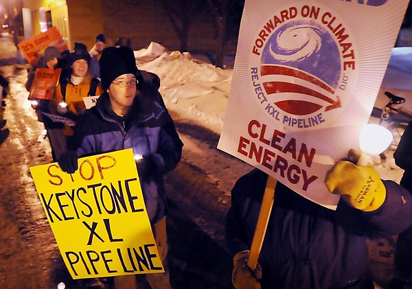 John Cross<br /> Picketers along the 400 block of South 2nd Avenue chant during a candlelight vigil on Monday in opposition to the Keystone XL pipeline. The protest came following a recent U.S. State Department report that raised no major objections to its construction.