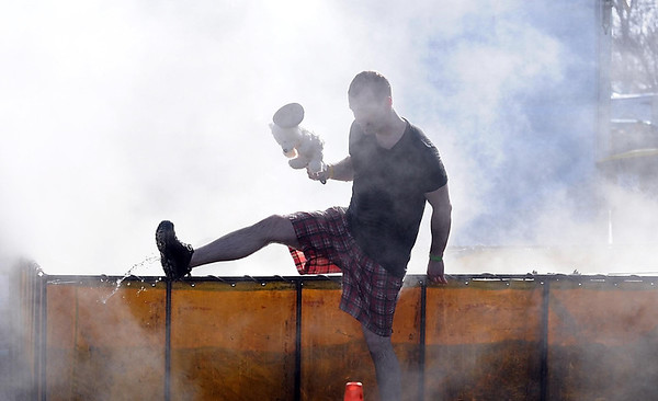 Pat Christman<br /> A jumper is surrounded by steam from a hot tub.