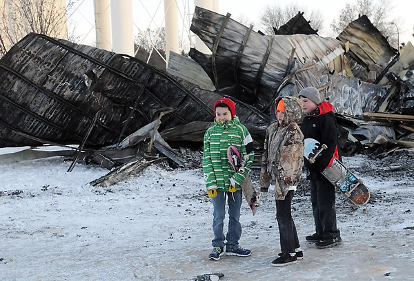 Pat Christman<br /> A trio of skaters gather near the remains of the Chelsey Roller Sport Park Wednesday evening. Users of the park gathered to take a group picture in front of the park, which was destroyed in a fire Saturday.