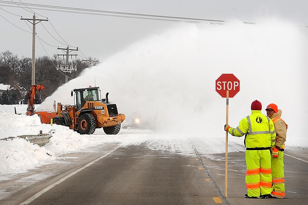 John  Cross<br /> A MnDOT rotary snowblower sends a giant plume of snow into the air along Highway 22 between Mankato and St. Peter on Wednesday. Motorists encountered minor delays as lanes were periodically closed as crews pushed back large snow drifts along a particularly troublesome section of the roadway.