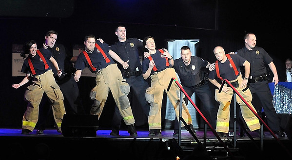 """Pat Christman<br /> """"Guns and Hoses,"""" a group of Mankato firefighters and police officers, perform during Dancing with the Mankato Stars Saturday."""