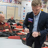 Kyle Pirron (right) of Mankato writes down names of possible delegates from Precinct 15 in a classroom at Mankato West during the Republican Caucus held on Tuesday evening. The precinct did not have enough people to volunteer for all 14 of the delegate seats allotted to the precinct. Photo by Jackson Forderer