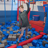Kallen Femrite (14) walks across the rolling log obstacle at the Conquer Ninja Warrior gym in Mankato on Wednesday. Kallen said it was his third time at the gym and he was working on obstacles he struggled with before. Photo by Jackson Forderer