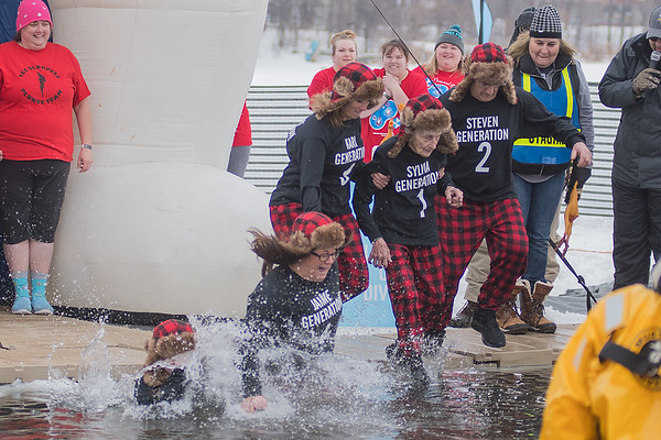 From left, Abby Havemeier, 10, Jaime Reinhart, 27, Kari Hanson, 43, Sylvia Reinhart, 90 and Stephen Reinhart, 69 jump into Hallett's Pond during the 13th annual Polar Plunge held in St. Peter. The five represented five generations of the Reinhart family from Lafayette and New Ulm. Photo by Jackson Forderer