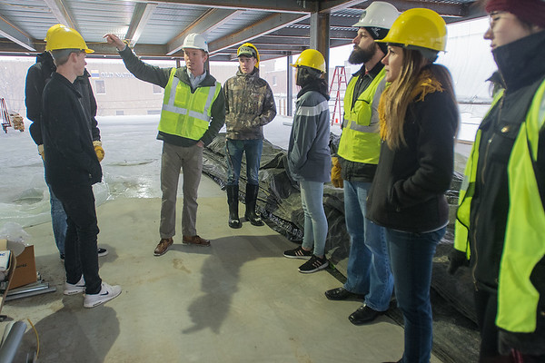 Collin Bennett Photo by (second from left) gives a tour of the Eide Bailly Center under construction to the Ace Mentor Program of Southern Minnesota on Tuesday. The program introduces participants to careers in architecture, construction and engineering. Photo by Jackson Forderer