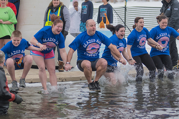 The Glazed and Confused team takes the Polar Plunge on Saturday. Photo by Jackson Forderer
