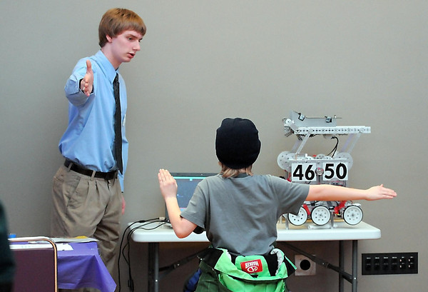 Watertown-Mayer High School senior Ryan Wade demonstrates his project on human interface devices in robots during Saturday's Science and Engineering Fair at Minnesota State University.