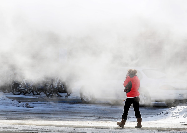 John Cross<br /> A Minnesota State University student is about to caught in a swirl of steam from the campus heating plant as she hurries to her residence hall in frigid weather.
