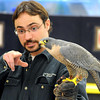 University of Minnesota Raptor Center's Mike Billington talks about how well the peregrine falcon he's holding can see Friday.