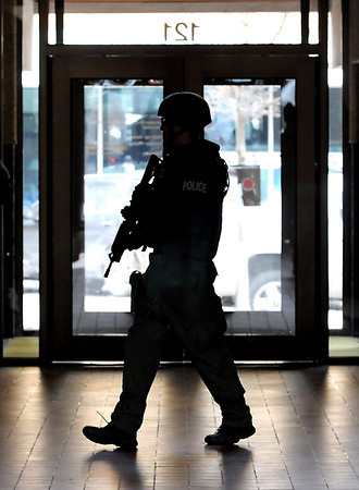 A River Valley Tactical Response Team member walks through the former US Bank building on the corner of South Second and Walnut Streets during a training exercise Thursday afternoon.