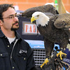 Mike Billington of the University of Minnesota's Raptor Center holds an adult bald eagle for first graders Friday at South Elementary School in St. Peter