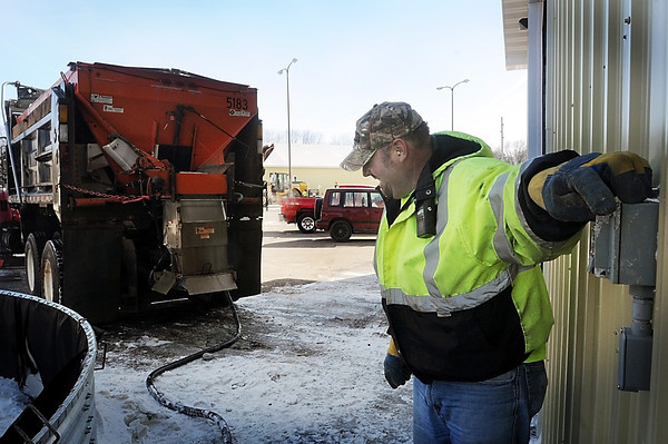John Cross<br /> Mankato Street Department employee Steve Morrison hits the switch to fill brine tanks on his plow truck Wednesday.<br /> He was laying down a brine solution on city streets to make snow removal easier in the event a Thursday snowstorm materializes as predicted.