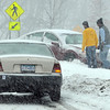 Pat Christman<br /> A vehicle sits on the curb at the intersection of Monks and Glenwood Avenues at the beginning of Thursday's storm.