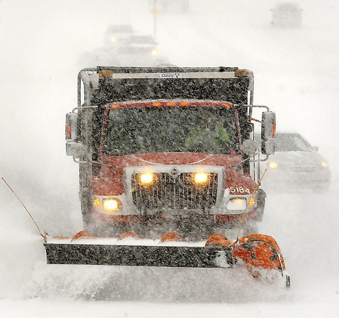 John Cross<br /> A city plow truck rumbles down a Mankato street on Saturday during this, the winter that won't quit.