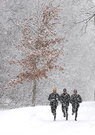 Pat Christman<br /> A trio of runners brave a winter storm to go for a run Thursday in Mankato. A winter storm moving into the area created slick roads and threatened to put 5 to 8 inches of fresh snow on the ground.