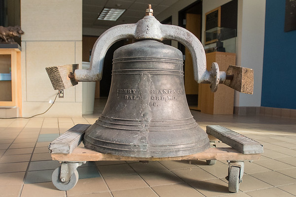 A bell that was mysteriously left outside of the doors of the Nicollet County Historical Society. The bell is believed to have originated from the old high school in St. Peter and the foundry that created the bell is still in existence in Baltimore. Photo by Jackson Forderer