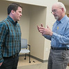 Tom Hagen (right) discusses park issues with North Mankato Public Works Director Brad Swanson at the end of a presentation on the city's parks plans. Hagen voiced concern over citizen input in the process. Photo by Jackson Forderer