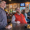 Dan Foster (center) and Tom Frederick (left) watch the US Curling Team take on the Swiss team at a curling watch party held at Pub 500 on Tuesday. Foster said he is fresh into curling and has been learning a lot from watching and viewing the Olympics web page that has every single stones throw on it. Photo by Jackson Forderer