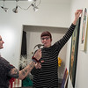 Olivia Sirek (left) hands a hammer to Kathryn Mast as the two hung artwork at the 410 Project for the upcoming annual juried exhibition which opens on Feb. 16. Award winners for the exhibit will be announced at the opening reception from 7-9 p.m. Photo by Jackson Forderer