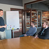Jordan Powers (left) of Made in Mankato works with Wesley Otto (right) and Mike Sargent about long-term goals for his business in a conference room at the newly opened Otto Media Group. Photo by Jackson Forderer