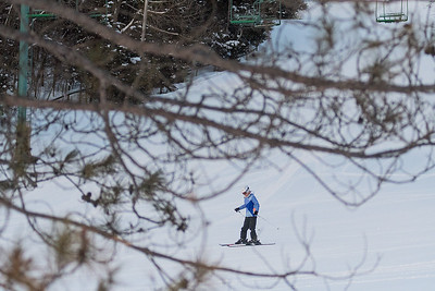 """A young skier finishes their run on one of the back slopes of Mount Kato on Friday. General Manager John Nelson said they haven't seen a big uptick of skiers yet, because people have been having troubles getting around but added, """"Once the weather normalizes, the extra snow will certainly help."""" Photo by Jackson Forderer"""