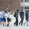 "Minnesota State University students head to the Otto Recreation Center, some wearing shorts, on Wednesday. When asked about the snow, fellow student Michael Messingham said, ""I mean, look at it,"" pointing to a large pile of plowed snow. Messingham's friend Josh Strusinki added, ""It's a little ridiculous."" Photo by Jackson Forderer"