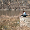 Hannah Guy, a Minnesota State student, types a paper while sitting in Sibley Park on Friday. Temperatures reached an unusually high 62 degrees. Photo by Jackson Forderer