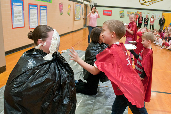Fourth-grader Spender Hed (right) throws a pie into teacher Katie Rotvold's face at Kennedy Elementary School on Tuesday. Four students were chosen to throw a pie into a teacher's face after the school raised $12,900 during their Jump Rope for Heart benefit for the American Heart Association, which surpassed their 2016 total of $11,200. Photo by Jackson Forderer