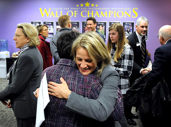 Cindra Kamphoff, director of the Center for Sport and Performance Psychology, gets a hug from a visitor to the center's open house and ribbon cutting ceremony Friday.