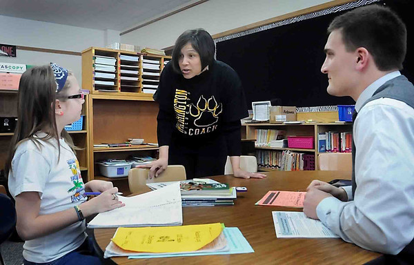 John Cross<br /> Minnesota Education Commissioner Brenda Cassellius visits with fourth grader Jordyn Kenward and student teacher Jake Berling during a visit to Washington Elementary School on Wednesday.